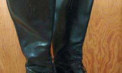 Women's leather riding boots Not even broken in yet. Size 7, 17 inch calf, 18 inches heel to top