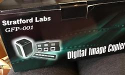 I used this to transfer slides to my computer and then to a VHS tape. It works very well and is like new. It comes with CD and instruction booklet. New price is $65.