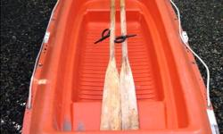 """High visiable safety orange polyethylene moulded dinghy ,rowboat, a tender for to and from shore comes with 6' oars and oarlocks shallow draft hull sealed watertight compartment 235 lbs /147 kgs capacity length 7' or 216 cms width 40"""" or 100 cms depth 16"""""""