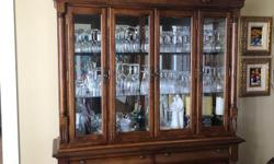 """Gorgeous quality wood buffet and hutch. Great storage for wine glasses and linens. Although I have never hooked it up, has lighting. Mirror back on hutch. Approx. measurements: 88"""" high at peak (80"""" at corner), 60.5"""" wide, 17"""" deep. Purchased at Bondars"""