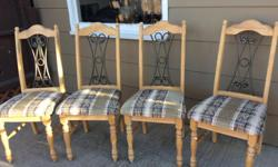Maple wooden chairs with rod iron backs. Fabric seats in earth tone, abstract design. Very good condition. Expensive when new. Strong sturdy construction. Can view anytime.