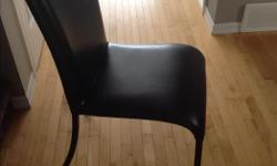 6 black padded leather chairs from Pier One Excellent condition Paid over 100 each