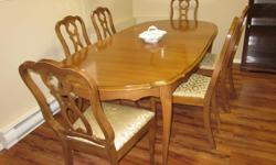 Dining Table with 2 leaves, six chairs including 1 captains chair, china cabinet. All in good condition.