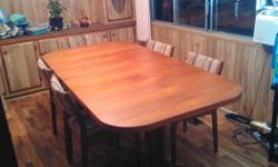 Teak dining room table with five chairs and two extension leaves...very nice dining set...located in Chemainus