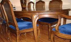 Excellent quality, dining table and 8 chairs by HENREDON. Please call at 604-941-0401 for more info or arrange time for viewing.