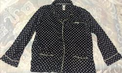 "Soft black and white polka dot fleece night shirt features two front pouch pockets, buttons stamped with DKNY and embroidered DKNY in white stitching on left chest. Measures 24"" between underarms (48"" chest) with stretch, 18"" underarm to hem, 18"" underarm"