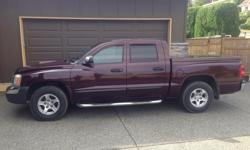 Make Dodge Colour Burgundy Trans Automatic kms 189000 2005 Dodge Dakota SLT, power windows, A/C, v8 Magnum, trailer hitch, tonneau cover, stainless side steps,remote starter, cloth interior, new tires, 4x4.Great truck, very well maintained. Asking $7900