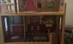 "Doll house 48""tall by 29"" wide, small damage in kitchen but still lots of life left. Comes with a few prices of furniture."