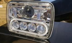Brand new set of 50w/80w 5x7 led conversion headlights. With white halo ring around the high beam. Cree chip, high/low, plug and play installation $200/pair Posted with Used.ca app