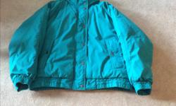 NORTH COUNTRY DOWN FILLED WINTER JACKET. ZIPPERED FRONT WITH FLAP COVERING . SLASH POCKETS, GREEN EXTERIOR SHELL WITH MAUVE INTERIOR LINING.SELDOME WORN, IN VERY GOOD CONDITION SIZE LARGE. WARM AND VERY COMFORTABLE