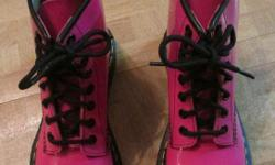 """I have for sale a pair of Dr. Martens. These boots are Doc Martens """"AirWair with Bouncing Soles"""". Like new, size 6, Acid Pink Patent Leather. Check the pictures, you will see they have hardly been worn - no tread wear. I am asking $90 or BEST OFFER"""