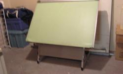 Professional Drafting Table.  Table is in like new condition.  Would be good for artist or child as a large easel.
