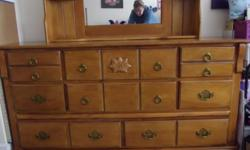 Dresser with 8 drawers, Mirror with 4 small shelves and one Night Stand with 2 drawers. In excellent used condition, from the spare bedroom. Must pick-up in Duncan.
