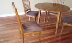 "Quality dining table and chairs manufactured by Ashley. The wood colour is a warm hickory, the chairs' upholstery is micro fiber fabric in brown. Very easy to keep clean. The table's diameter is 41 1/2"", the height 30 1/2"". The set is in very good"