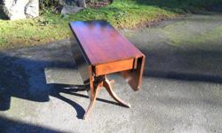 Drop leaf table. good condition. call or email John