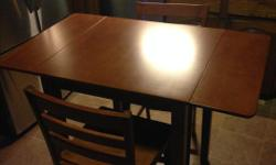 Small wood drop leaf table with two chairs in good shape Counter height
