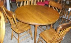 "Solid Wood Drop Leaf Table with Four Chairs in excellent condition, table dimensions are 42"" Dia. when leafs are extended and 22""W x 42""L with the leafs in the down position. Asking for $375.00"