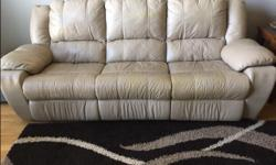 Dual power reclining genuine leather sofa. Power recliner on both ends. Very comfortable. Used approximately 3-4 years, still has lots of life left. Colour is warm beige. Non smoking home. $500. Would make a great TV room comfy couch.