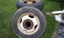 8 Bolt rims with 8.75 R 16.5LT tires  came off of chevy Best Offer