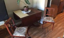 Antique Duncan Phyfe Dining Table with drop leaf and 5 chairs. In good condition. Comes with a vinyl cover for top of table. 250 or O.B.O.