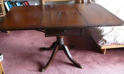 Duncan Phyfe Table, dark with drawer, $130, 250-727-7636