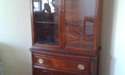 China cabinet - good condition - may need some refinishing. Glass doors on top section. One drawer. One shelf on both top and bottom sections. Solid doors on bottom section.