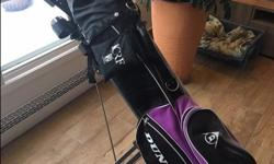 Dunlop Golf Club Set, Bag and Cart. Right-handed. Used, good condition, sold as is. Clubs (13): driver, 3 woods, 6, 7, 8, 9 iron, sand wedge, pitching wedge, 2 putters. Bag: Dunlop brand, self-standing (built-in tripod), multiple zipper pockets, 20 golf