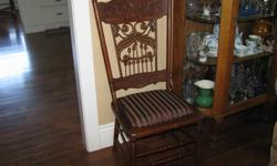 This unusual chair has wicker spindles and bobbins on the back. It is in excellent condition with a newly upholstered seat. Circa early 1900s.