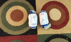 White and blue hockey elbow pads