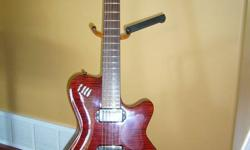 This is a great guitar. I'm not sure of the age but I have owned it for about 8 years.  It has some light scratches on the back and the clear pick guard on the front has been removed.  It does need a fret job which would cost around $125.00 which I have