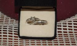 14k gold engagement and wedding band set. 1.5c total diamond weight. wedding band has never been worn. paid 1400 for set and asking 800 obo..