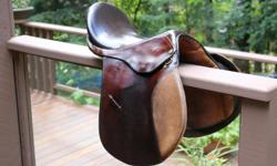 Two tone, brown Country Club saddle with girth. 17 inch seat with medium tree.