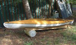16 ft double kyak with open cockpit. Canvas covered hand built wood frame Wood solid, but needs new canvas. Rudder kit included