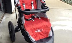 Excellent used condition Baby Jogger Summit X3 running stroller - Orange/grey colour - Comes with child tray, parent console and rain cover - Single action fold - All wheel suspension - Every wheel can easily be removed to save space More information can