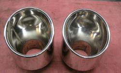 "Pair chrome tail pipe finishers. Pipe diameter 2.25"". Located in Cobble Hill. No texts."