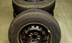 4 M+S P205/75 R14 Tires   With 5 bolts, shiney steel rims; fits a Plymont Voyager Minivan   Previously used for only 3 months