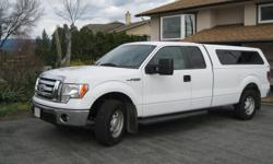 Make Ford Model F-150 Series Colour White Trans Automatic kms 83900 THIS SENIOR HAS TO SELL HIS BABY! Super clean, dealer serviced; 5.4 L V8 Engine and electronic 6-speed Auto; factory installed Max Trailer Tow and Heavy Duty packages; Full 8 foot box