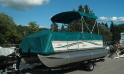 """Attractive, 18'3"""" pontoon boat, Model Mirage CRS 818 by Sylvan. Comes rigged with Bimini top, Full playpen cover, windscreen, docking lights, built in fuel tank,and boarding ladder. Included is a Mercury 40 HP 4S Big Foot Outboard motor. Full warranty."""