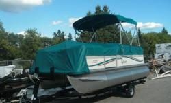 """Attractive 18'3"""" Pontoon boat, Model: Mirage CRS 818 by Sylvan. Comes rigged with Bimini top, full playpen cover, windscreen, docking lights, built in fuel tank and boarding ladder, Lots of seating. Included is a Mercury 40 hp 4Stroke Big Foot outboard"""