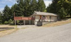 # Bath 2 Sq Ft 2508 MLS 412910 # Bed 4 This large home sits on .60 of an acre in the heart of Maple Bay. It features 4 bedrooms on the main with a large, entertainment size deck, and a large family room and den down. The large corner lot offers plenty of