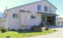 # Bath 2 Sq Ft 2518 MLS 404488 # Bed 4 Located on a cul de sac sits this wonderfu, bright and sunny Lake Cowichan family home. This well constructed home offers of plenty of room for any growing family with over 2,500 sq ft. The main level offers an open