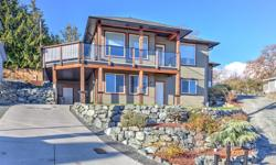 # Bath 3 Sq Ft 2972 MLS 448324 # Bed 4 MORTGAGE HELPER! Quality built (2015) home by Trent Radcliffe Construction. This home with separate 1 bed legal suite has it all! The main level has generous living space with nat gas fp, fantastic mountain views,