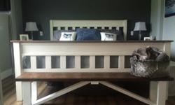 Rustic farm house bench can be used for a multitude of purposes. Perfect at a dining table, in a hallway also works great at the foot of a King size bed. very versatile, rustic wood nicely finished. Dark stained top white painted legs. Located in Mill Bay