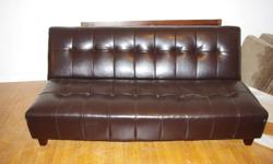 Faux brown leather Futon In Good condition Came from Sears. Org Price. $599. Solid construction in tufted high quality faux brown leather. Space saver as extra bed This stylish sofa easily converts from sofa to bed in 2 easy kliks. High quality faux brown