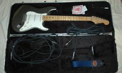 1988 Fender American made, Stratocaster electric guitar. Gun metal/metallic flake paint. Rosewood in-lay on back of neck neck. Heavy duty frets. With light wear and no pitting. Whammy bar good shape. All 5 bridge tension springs included. Normal wear on