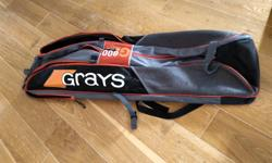 Barely used, holds at least 3 sticks + lots of gear Shoulder straps, tonnes of pockets Make = Grays G800