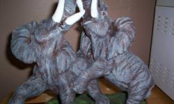 Hand cast, Hand painted and signed. Great collectable, Great gift