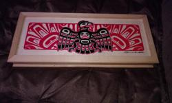 It's a cute little stashed box with a First Nations Thunderbird sunset in the back design on the top had it in our house for a long time not using it handmade we bought it long time ago text me if your interested 778-239-1566