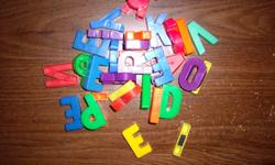 several magnetic letters and magnetic numbers
