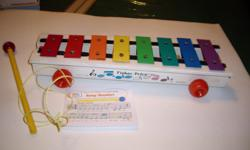 WITH color coordinated music book, baton, cord. good condition and ready to play